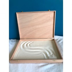 La boîte pour dessiner dans le sable